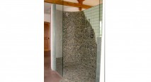 Ecological riverstone shower tiles.