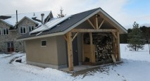 Off-the-grid wood-fired boiler room built out of timber frame and straw bale