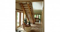A naturally-finished timber frame staircase