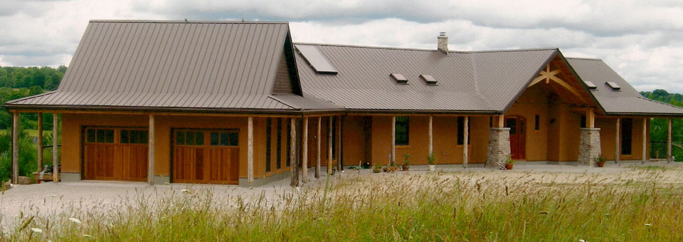 Timber frame house with straw bale walls clay floors for Timber frame straw bale house plans