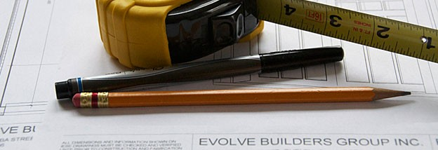 Green jobs and careers symbolized by a set of blueprints and a tape-measure